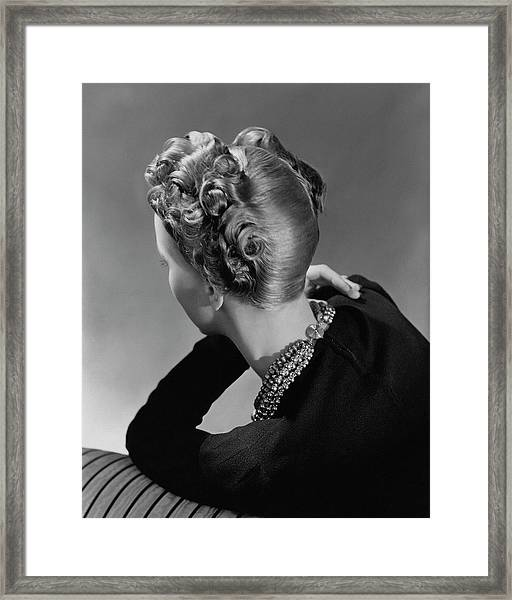 A Model Wearing A Curled Hairstyle Framed Print by John Rawlings