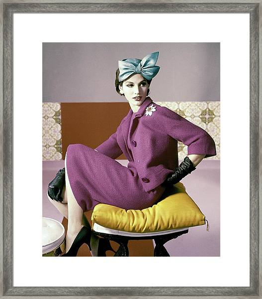 A Model Wearing A Dress Suit Framed Print