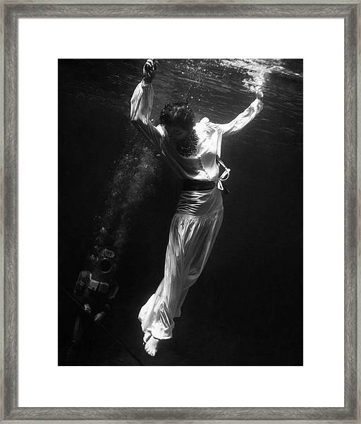 A Model Wearing A Dress Underwater Framed Print