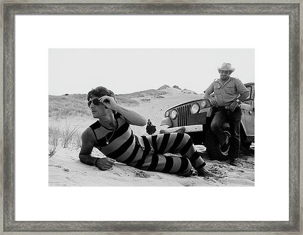 A Model Wearing A Drummond Tank-suit Framed Print by Mark Patiky