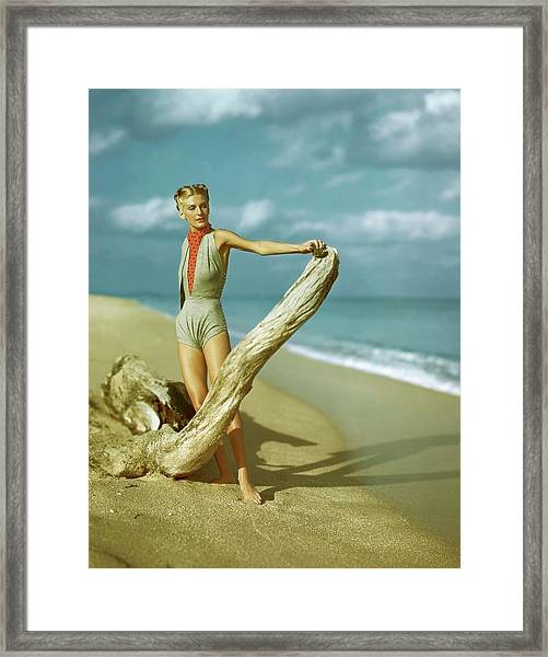 A Model Wearing A Gray V-midriff Swimsuit Framed Print
