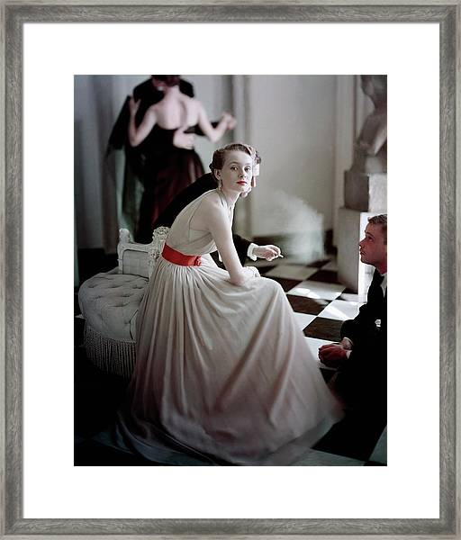 A Model Wearing A Harry Keiser Dress Framed Print
