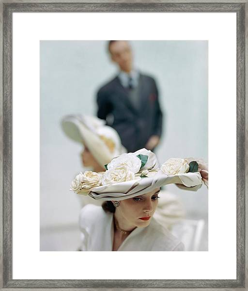 A Model Wearing A Hat Decorated With Flowers Framed Print