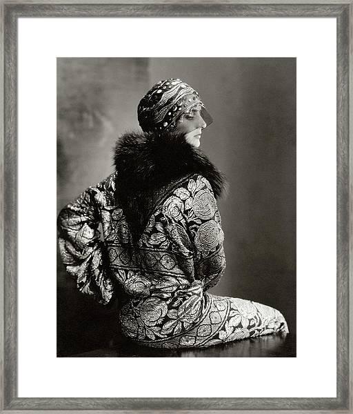 A Model Wearing A Headdress And Brocade Coat Framed Print by Edward Steichen