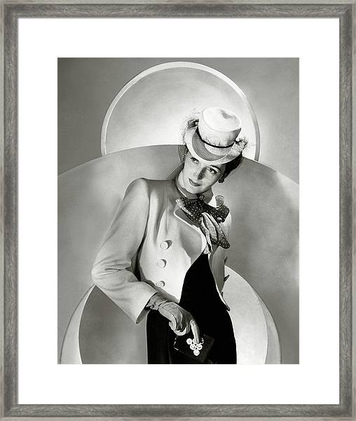 A Model Wearing A Jacket And Hat Framed Print