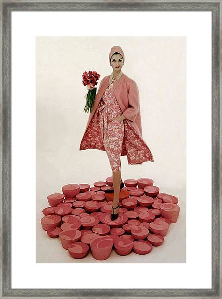 A Model Wearing A Matching Pink Outfit Holding Framed Print