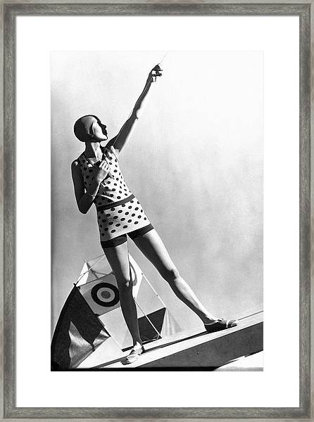 A Model Wearing A Polka Dot Swimsuit Framed Print