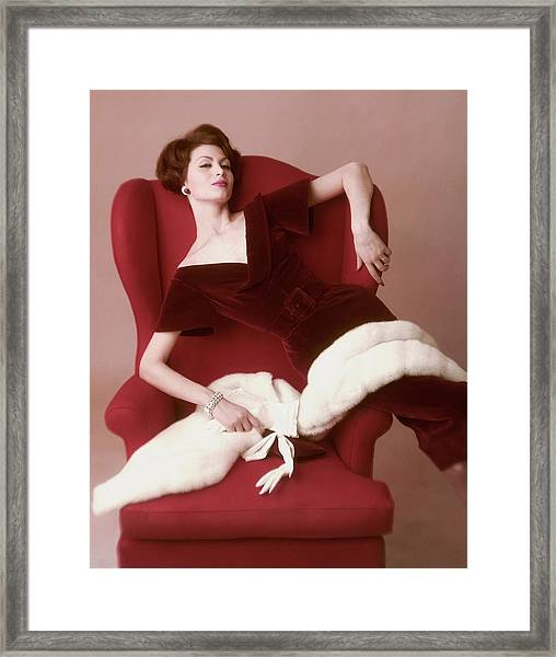 A Model Wearing A Red Velvet Dress Framed Print by John Rawlings
