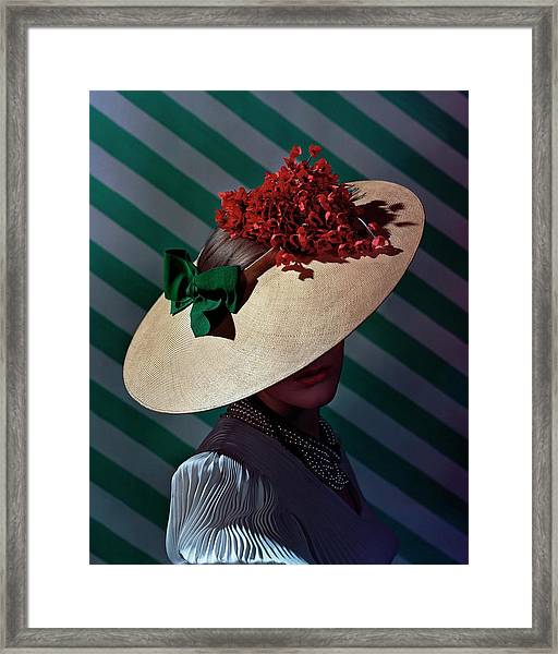 A Model Wearing A Straw Hat Framed Print