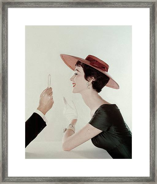 A Model Wearing A Sun Hat And Dress Framed Print by John Rawlings