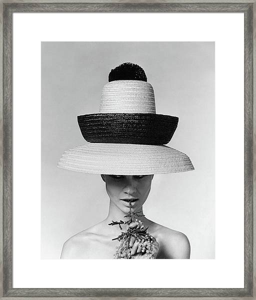 A Model Wearing A Sun Hat Framed Print