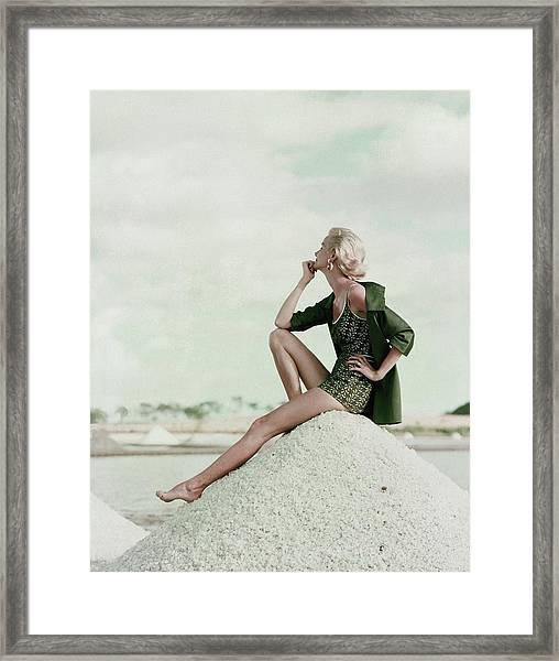 A Model Wearing A Swimsuit And Jacket Framed Print