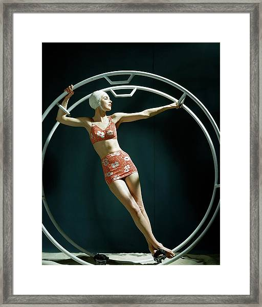 A Model Wearing A Swimsuit In An Exercise Ring Framed Print