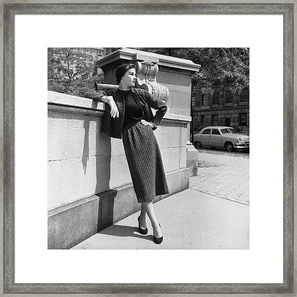 A Model Wearing A Tweed Suit Framed Print