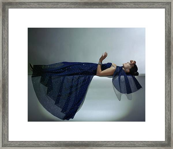 A Model Wearing An Evening Gown Framed Print by John Rawlings