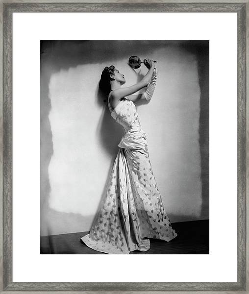 A Model Wearing Leaf Patterned Dress Framed Print by Cecil Beaton