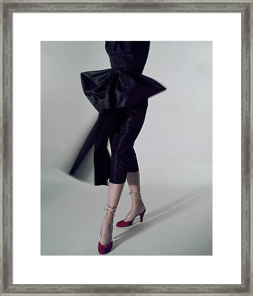 A Model Wearing Red Shoes Framed Print by Serge Balkin