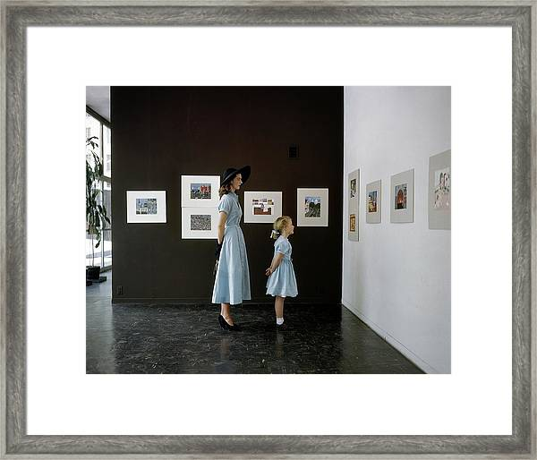 A Mother And Daughter At Moma Framed Print