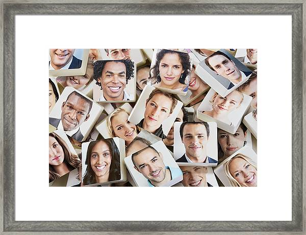 A Pile Of Discs With Smiling Faces On Them Framed Print by Dimitri Otis