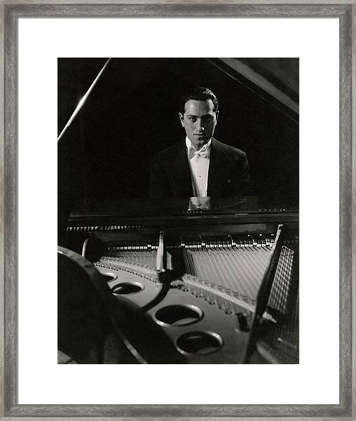 A Portrait Of George Gershwin At A Piano Framed Print