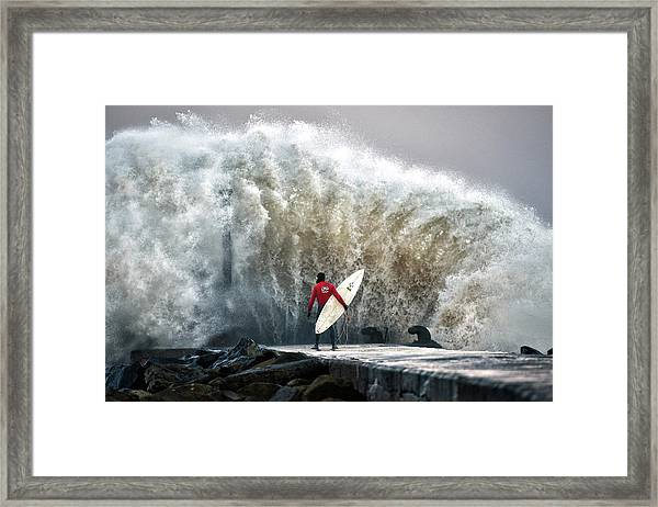 A Pro-surfer Waits For A Break In The Framed Print by Charles Mcquillan