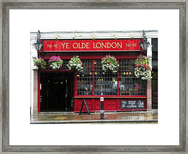 Framed Print featuring the photograph A Rainy Day In London by Mel Steinhauer