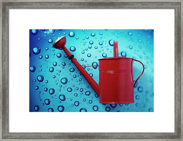 A Red Watering Can Framed Print