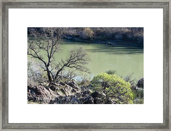A River In Wintertime Framed Print