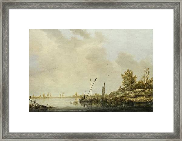 A River Scene With Distant Windmills Framed Print
