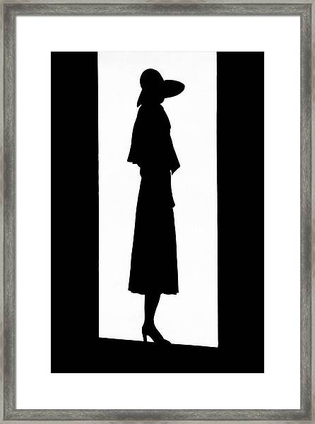 A Silhouetted Woman Framed Print