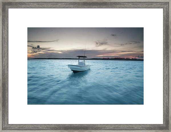 A Skiff Anchored Off The Coast Of Cat Framed Print