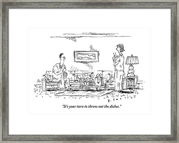 A Standing Woman Speaks To Her Sitting Husband Framed Print