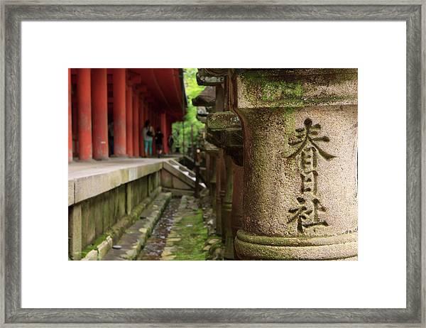 A Stone Pillar Which Reads Kasuga Framed Print by Paul Dymond