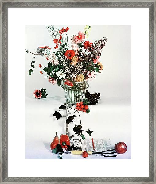 A Studio Shot Of A Vase Of Flowers And A Garden Framed Print
