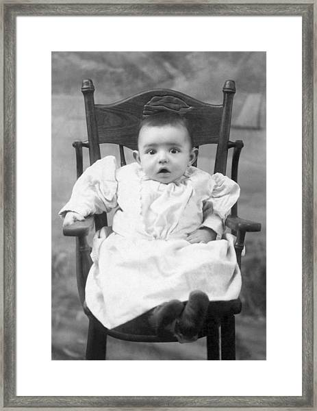 A Surprised Baby Portrait Framed Print