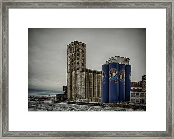 A Tall Blue Six-pack Framed Print