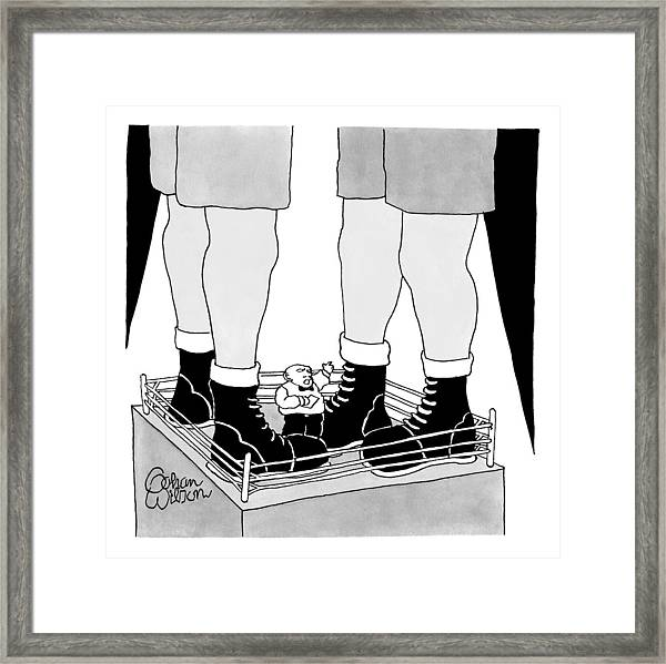 A Tiny Emcee In A Boxing Ring Is Seen Standing Framed Print