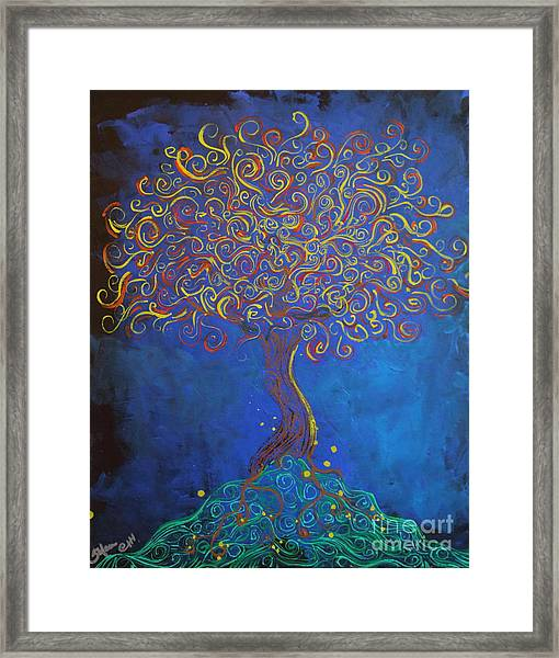 A Tree Of Orbs Glows Framed Print
