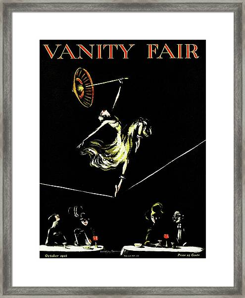 A Vanity Fair Cover Of A Woman Tightrope Walking Framed Print by Artist Unknown
