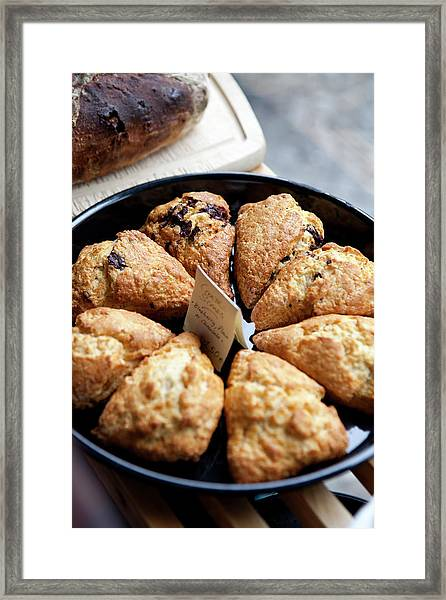 A Variety Of Scones For Sale On Display Framed Print