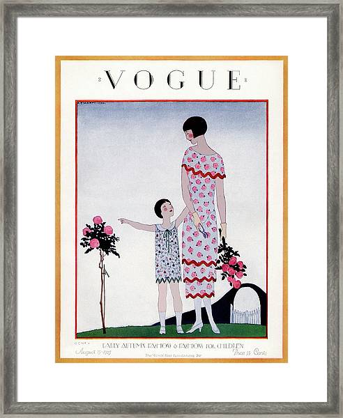 A Vintage Vogue Magazine Cover Of A Child Framed Print