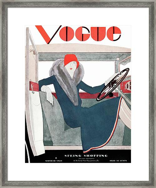 A Vintage Vogue Magazine Cover Of A Woman Framed Print by Pierre Mourgue