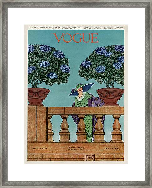 A Vogue Cover Of A Woman At A Balustrade Framed Print