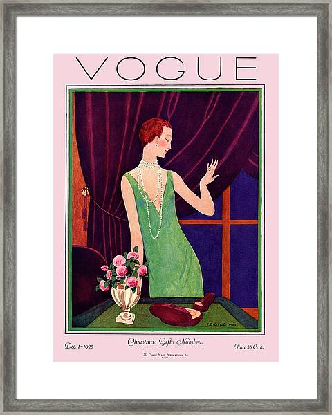 A Vogue Cover Of A Woman Trying On Jewelry Framed Print by Pierre Brissaud