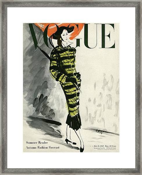 A Vogue Cover Of A Woman Wearing A Striped Coat Framed Print