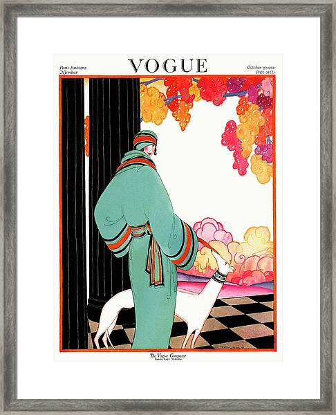 A Vogue Cover Of A Woman With A Dog Framed Print