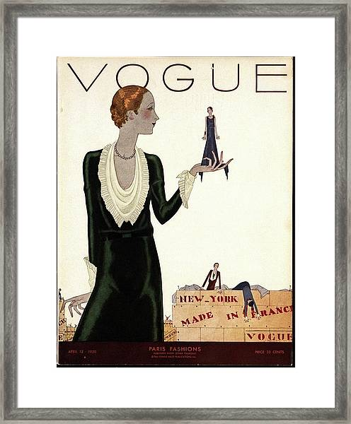 A Vogue Cover Of A Woman With Mannequins Framed Print