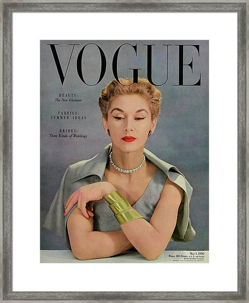 A Vogue Magazine Cover Of Lisa Fonssagrives Framed Print by John Rawlings