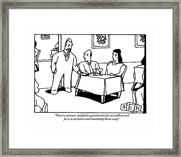 A Waiter Speaks To A Couple At A Restaurant Table Framed Print