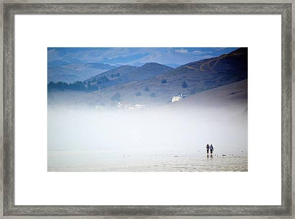 A Walk In The Evening Fog Framed Print